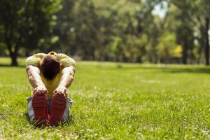 man stretch on grass
